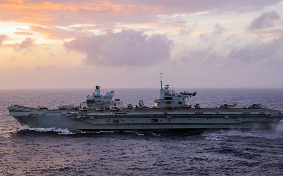 The aircraft carrier HMS Queen Elizabeth, pictured here sailing through the South China Sea last week, made a port call at U.S. Naval Base Guam on Friday, Aug. 6, 2021.