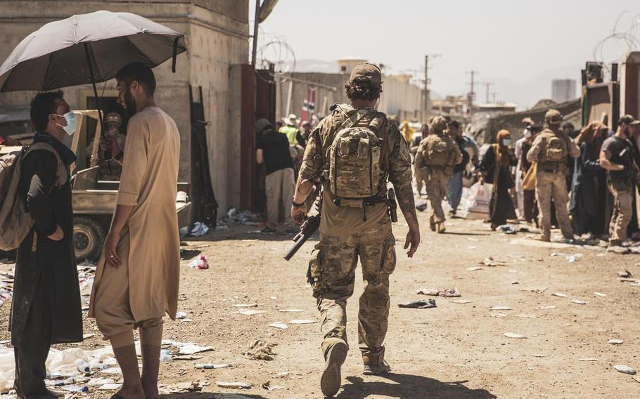 A Canadian coalition forces member walks through an evacuation control checkpoint during an evacuation at Hamid Karzai International Airport, in Kabul, on August 24, 2021.