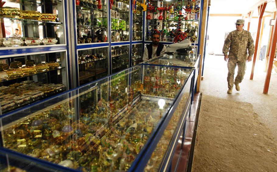 A trove of trinkets shimmer in the glass cabinets of an Army and Air Force Exchange Service shop at Bagram Airfield, Afghanistan in 2006.