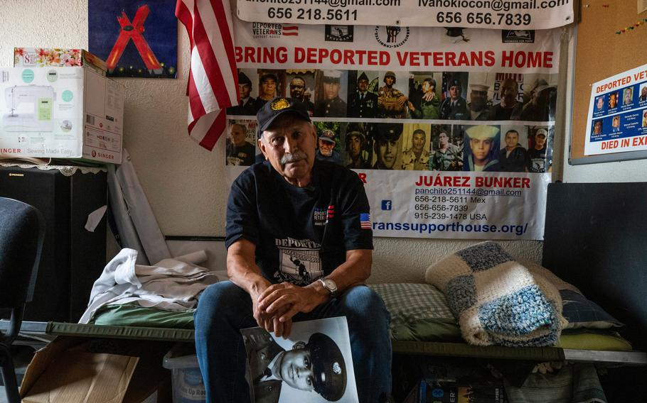 """Francisco Lopez was drafted at a teenager to go fight in the Vietnam war in 1967. He became a drug addict upon returning to the U.S. and was prosecuted for drug possession and consequently deported to Mexico. He remains hopeful that one day he can return to what was his home for most of his adult life in the U.S. In this photo, Lopez holds a photo of himself as a teenager in military attire in the """"Juarez Bunker,"""" a support shelter for deported veterans."""