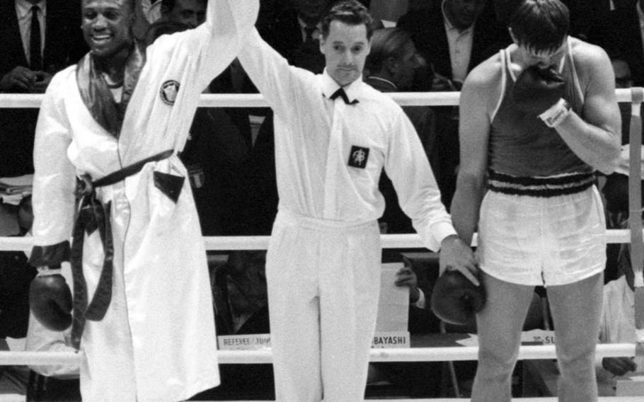 Joe Frazier of the United States is declared the winner over Vadim Yemelyanov of the Soviet Union during the heavyweight boxing semifinals at the 1964 Olympic Games in Tokyo. Frazier went on to win the gold medal.