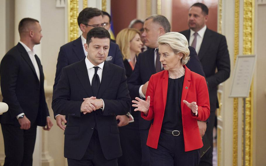 Ukrainian President Volodymyr Zelenskyy, left, and European Commission President Ursula von der Leyen share a word as they meet on the occasion of a Ukraine EU summit, in Kyiv, Ukraine, Tuesday, Oct. 12, 2021. The 23rd summit between the European Union and Ukraine is held in Kyiv.