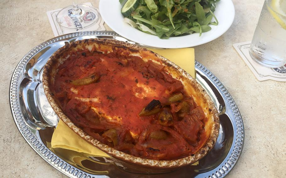 The schafskaesepfaennchen, or little sheeps cheese pan, at Piazza in Griesheim, Germany. It's a slab of feta cheese baked in a tomato sauce with peppers. At rear is the small piccola salad with lettuce, rocket, tomatoes and cucumber.
