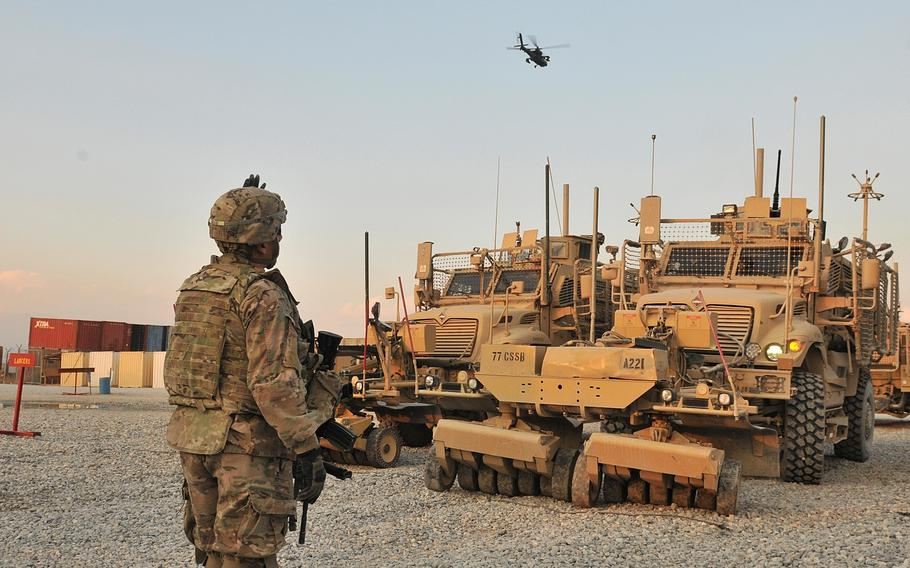 Staff Sgt. Jose A. Antepara guides a vehicle at Bagram Airfield, Afghanistan, as part of preparation for an upcoming mission in December 2013.