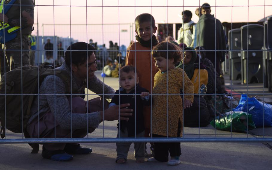 An Afghan family prepares with others to depart Ramstein Air Base, Germany, Sept. 2, 2021. So far more than 22,000 evacuees from Afghanistan have flown through Ramstein to the United States or other destinations.