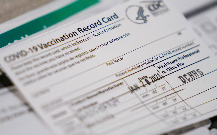 Vaccination record cards sit ready at a station at the Dallas County  COVID-19 mega-vaccination site at Fair Park, Texas, on Friday, Jan. 22, 2021, in Dallas.