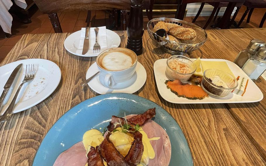 The eggs benedict, left, and the Belgravia, right. The Belgravia comes with smoked salmon, horseradish, crab salad, a slice of pate and different spreads for the breakfast rolls at The Victorian House, July 2, 2021 in Munich, Germany.