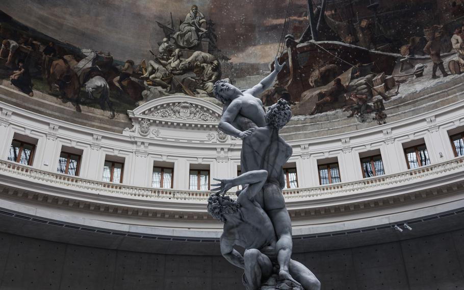 """A replica of the 16th-century sculptor Giambologna's """"Rape of the Sabine Women,"""" one of nine wax figures that comprise Urs Fischer's 2011-2020 work """"Untitled"""" at the """"Ouverture"""" exhibition in the Boerse De Commerce in Paris on May 14, 2021."""