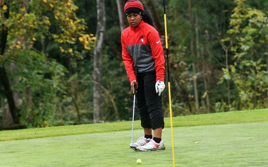 Asia Andrews, a freshman at Kaiserslautern High School, attempts to sink a putt during the DODEA-Europe golf championships at Rheinblick Golf Course in Wiesbaden, Germany on Wednesday, Oct. 6, 2021.