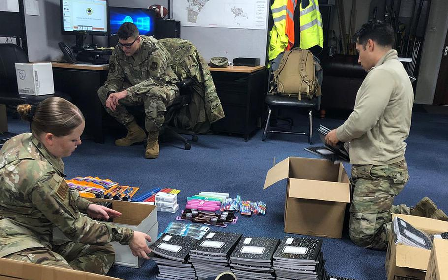 Tech Sgt. Fariht Gomez, right, and other service members package supplies donated by the RAF Lakenheath community in April to help a Maasai village in southern Kenya. Gomez has coordinated the collection of about two tons of items, including school supplies and clothing, he said.