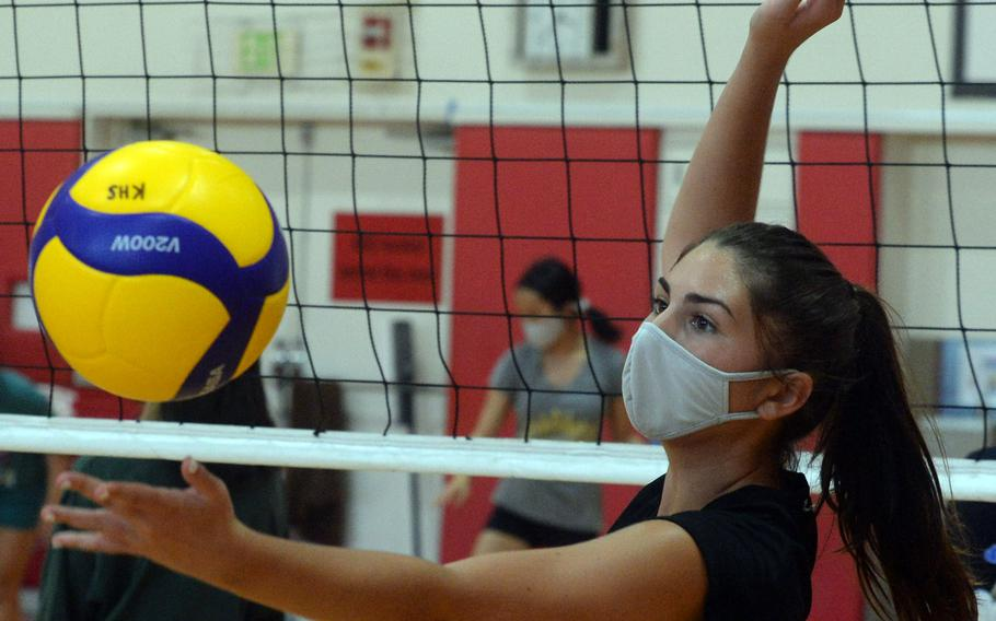 Junior setter Jillian Stevens is one of two players on Nile C. Kinnick's volleyball team who have their father as coach. Jillian's father is Red Devils assistant coach Travis Stevens and head coach Tony San Nicolas' daughter Cierra, a junior, is also on the team.