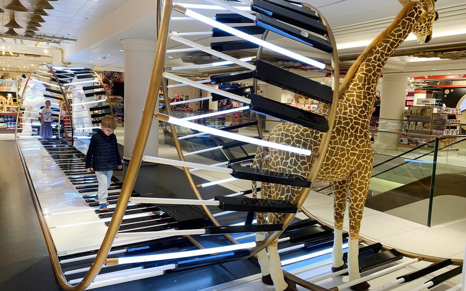 A piano installation in the Selfridges store on Oxford Street in London.