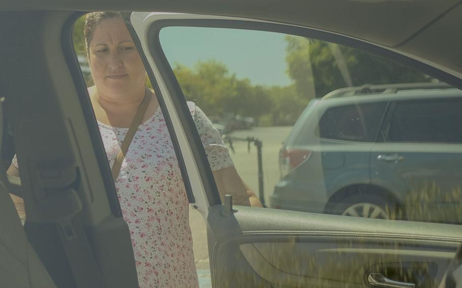Wendy Latella gets into her car after running errands around Fredericksburg, Va.