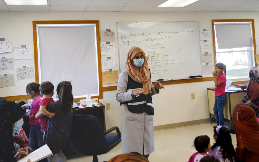 Afghan women and children learn English at Fort McCoy, Wisconsin, September 28, 2021. The base has approximately 13,000 evacuees living in barracks awaiting relocation to the United States.