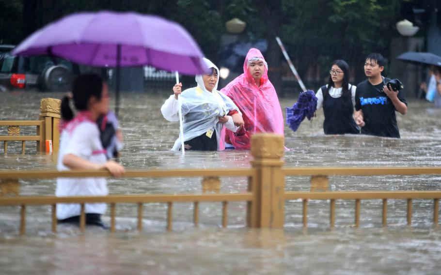 China's military has blasted a dam to release floodwaters threatening one of its most heavily populated provinces.