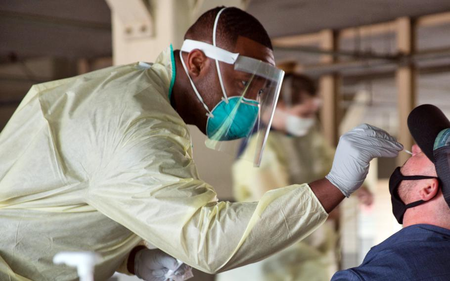 A member of the 51st Medical Operations Squadron tests a service member for coronavirus at Osan Air Base, South Korea, July 14, 2020.