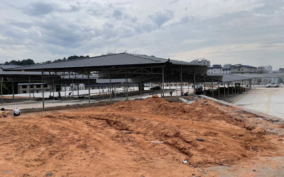 A new community market under construction in China's Enshi city on Sept. 11. At least six markets were permanently shut down in the city during the first three months of 2020 to comply with sanitation orders as the coronavirus emerged.