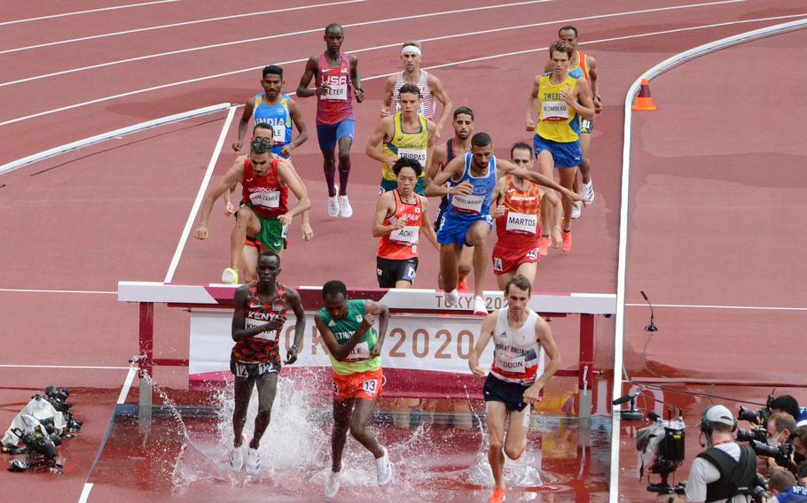 Army Spc. Benard Keter trailed the pack for the first half of his heat in the Olympic men's 3,000-meter steeplechase at Tokyo's National Stadium, Friday, July 30, 2021.
