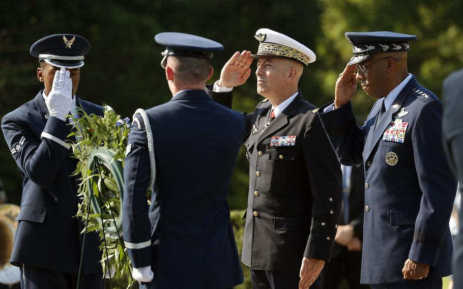 French Air and Space Force Chief of Staff Gen. Philippe Lavigne, center, and United States Air Force Chief of Staff Gen. Charles Q. Brown, right, salute Wednesday morning, July 7, 2021, after placing a wreath in front of the Yorktown Victory Monument.