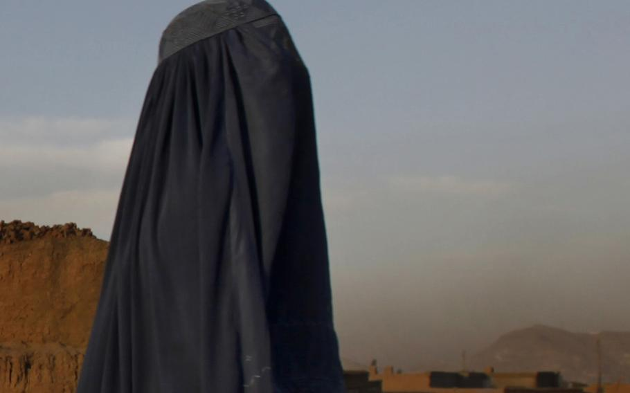 An Afghan woman in a burka walks through a suburb of Kabul, Afghanistan, on Sept. 25, 2010.  On Saturday, Sept. 11, 2021, women in full face veils rallied in support of the Taliban and its policies of gender segregation, a demonstration that was flanked by Taliban fighters carrying machine guns and rifles.
