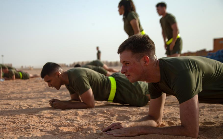 U.S. Marines hold a plank during Corporals Course physical training in Saudi Arabia, June 6, 2021. The Corps is doing away with crunches as part of its fitness test and replacing them with planks.
