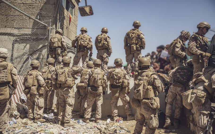 U.S. Marines with Special Purpose Marine Air-Ground Task Force - Crisis Response - Central Command, assist with security at an Evacuation Control Checkpoint during an evacuation at Hamid Karzai International Airport, Kabul, Afghanistan, Aug. 26, 2021.