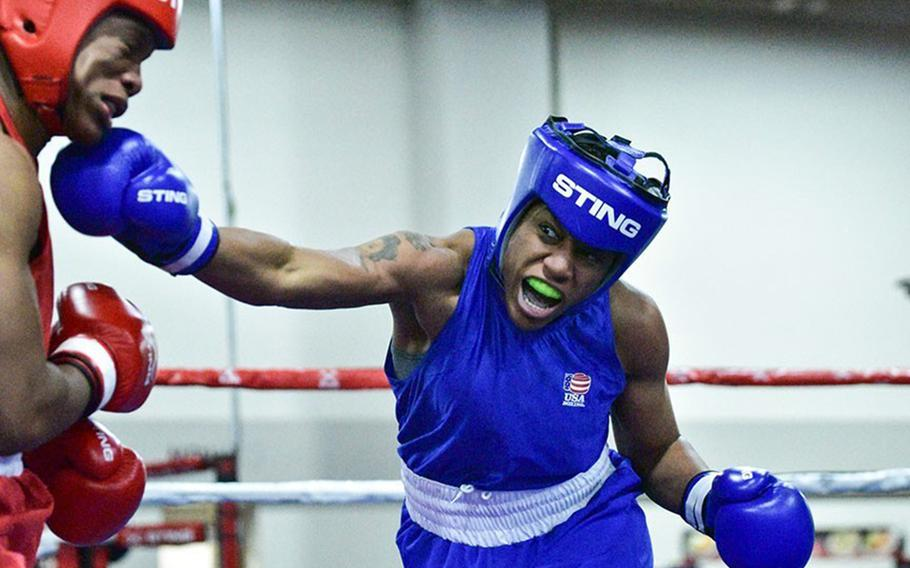 Staff Sgt. Naomi Graham throws a right to the chin of Briana Che during a USA nationals bout at Salt Lake City, Utah, in December 2019.