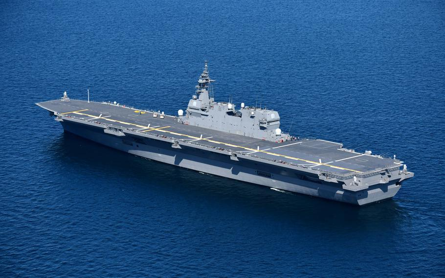 The JS Izumo, a Japanese helicopter carrier, conducts training with Marine Corps F-35B Lightning II stealth jets in the Philippine Sea, Sunday, Oct. 3, 2021.