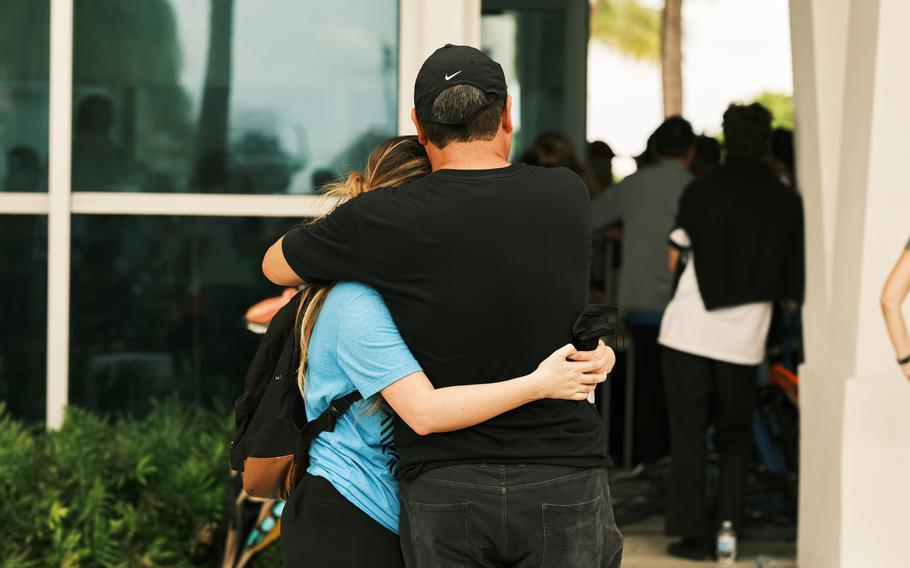 Friends and family wait for news about missing loved ones at the Surfside Community Center.