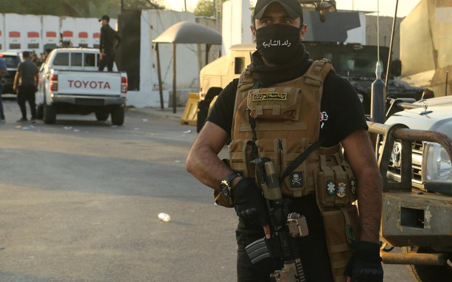 Popular Mobilization Forces surround the heavily fortified Green Zone, where the Prime Minister's offices are located in Baghdad, Iraq, Wednesday, May 26, 2021.