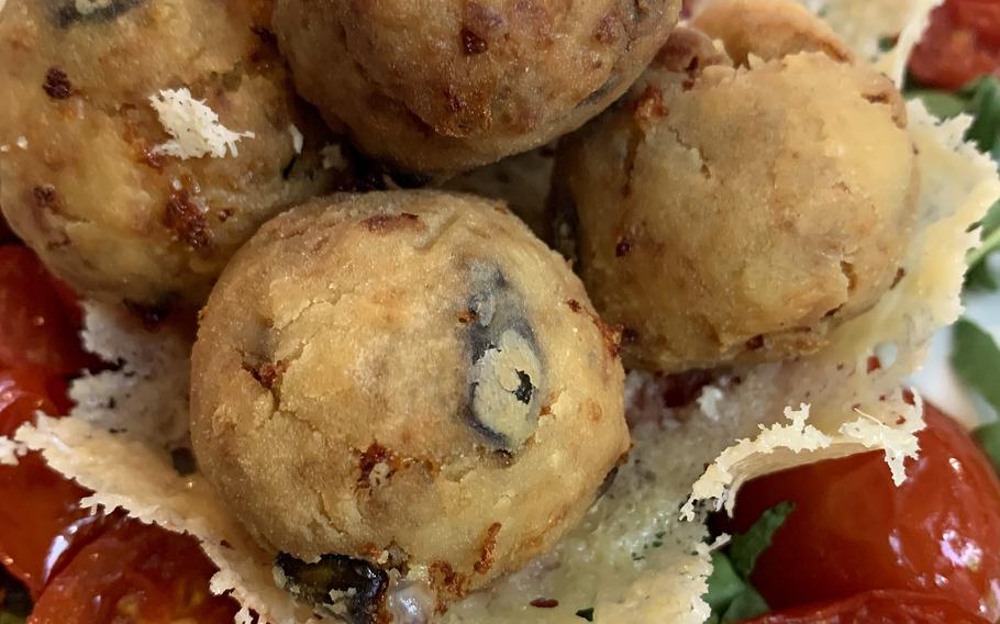 """Donna Imma's Meatballs at Johnny Ue in Naples, Italy, are made with eggplant, provolone cheese and beef. They are served in a Grana Padana """"basket"""" along with seared tomatoes."""