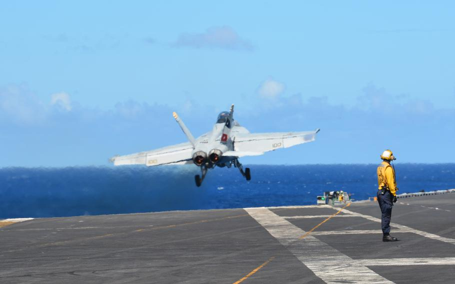 An F/A-18 Super Hornet takes off from the USS Carl Vinson on Aug. 14, 2021, as the carrier steamed north of Hawaii during Large-Scale Exercise 2021.