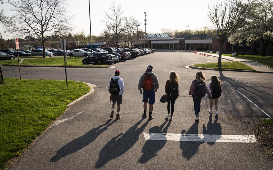 Senior students catch up as they return to in-person school for the first time this year at Sherwood High School in Maryland in April 2021.