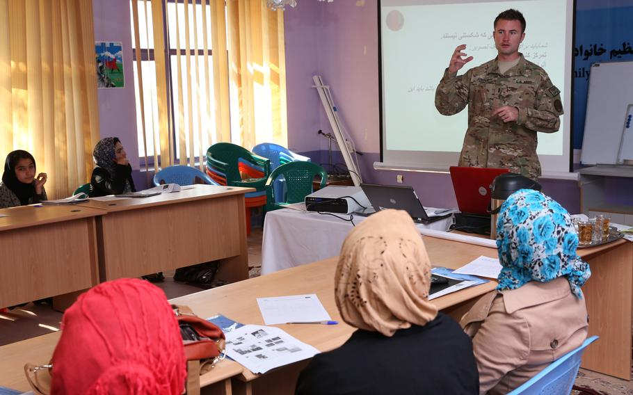 U.S. Navy Lt. j.g. Matthew Stroup, a public affairs officer, discusses photography with journalists during training in Farah, Afghanistan in 2013. The U.S. invested millions to support Afghan media.