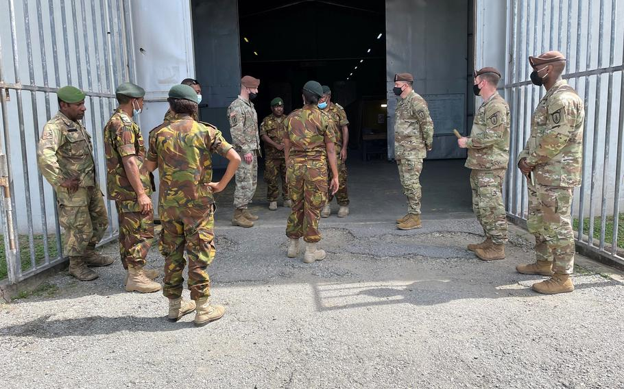 Papua New Guinea Defense Forces personnel brief members of the 5th Army Security Assistance Brigade at a supply warehouse in Murray Barracks, Papua New Guinea, May 24 2021.