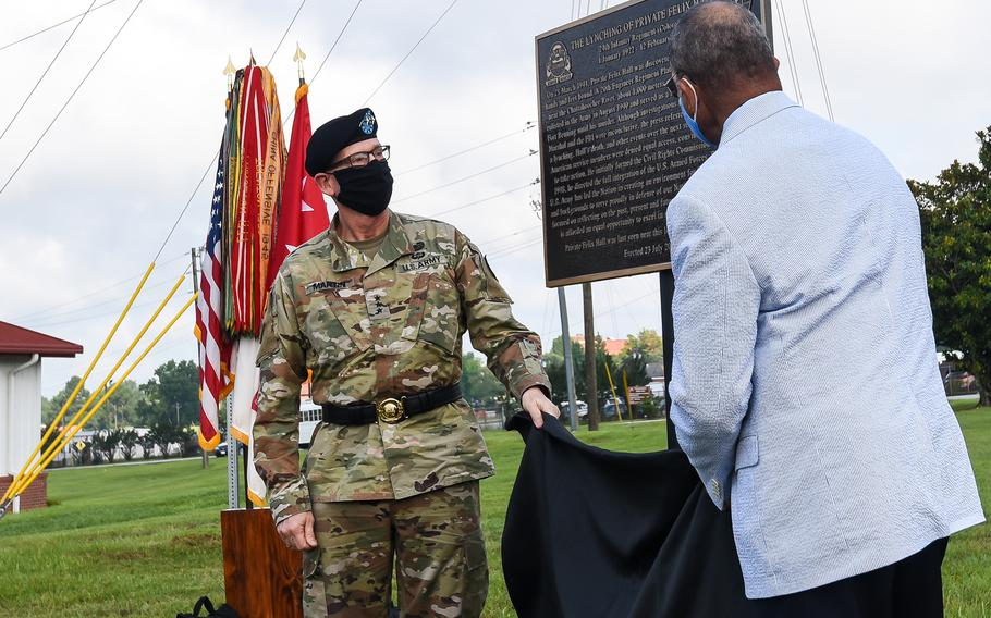 Rep. Sanford Bishop, D-Ga., right, and Army Lt. Gen. Ted Martin, the commander of the Army's Combined Arms Center reveal a historical marker in remembrance of Pvt. Felix Hall at Fort Benning, Ga. on Tuesday, Aug. 3, 2021. In 1941, the 19-year-old Hall, a member of the Army's Black-only 24th Infantry Regiment, was lynched on the Army post. He is the only known victim of a lynching on a U.S. military installation.