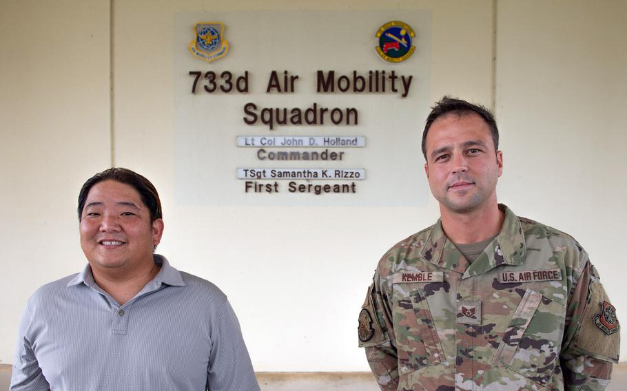 Air Force Staff Sgt. Kyle Kemble, right, and civilian employee Brandon Yoneda got the surprise of a lifetime on June 13, 2021, when they came across a group of exhausted Japanese kayakers bobbing in the sea off the western coast of Okinawa.