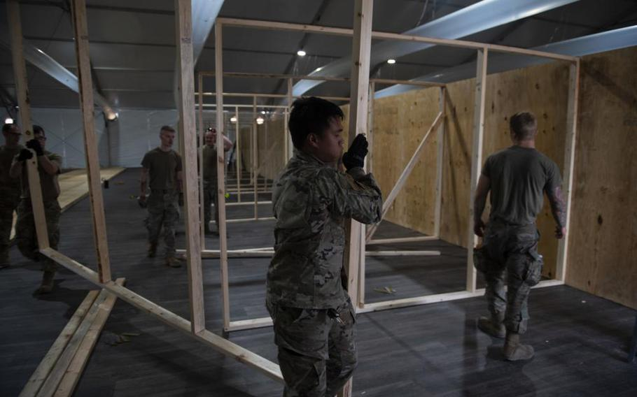 Airmen from Task Force-Holloman build partitions in a newly constructed living area at the Afghan personnel camp on Holloman Air Force Base, N.M., August 31, 2021.