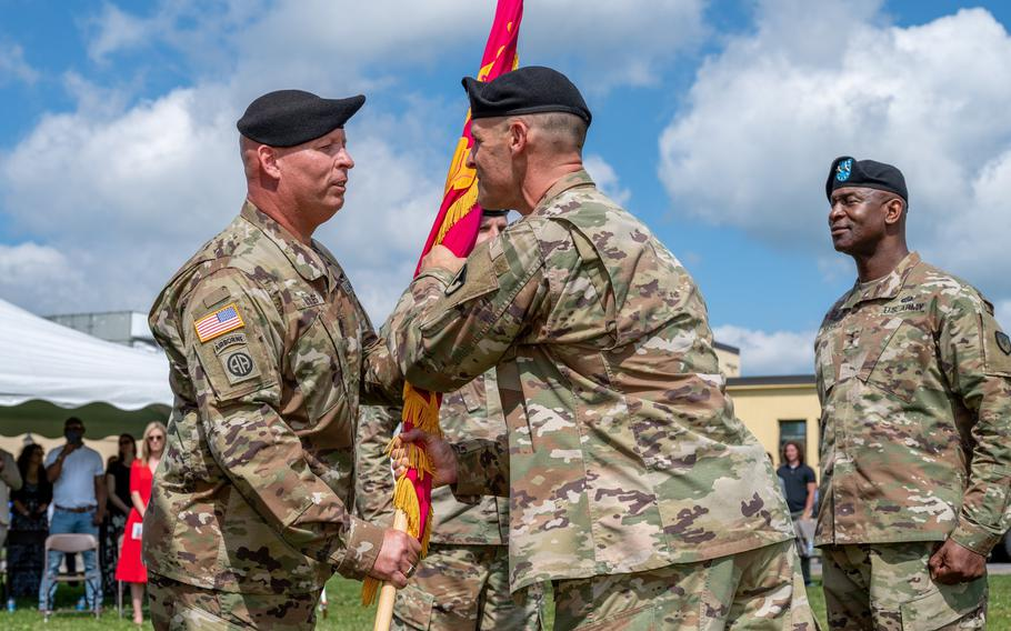 Sgt. Maj. Michael J. Wiles assumes responsibility as Sergeant Major of Tobyhanna Army Depot on June 28, 2021, as the new commander, Col. Daniel Horn, passes the flag.