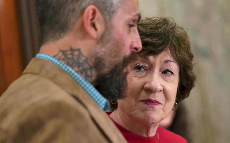Sen. Susan Collins, R-Maine, with D.C. police officer Michael Fanone in May.