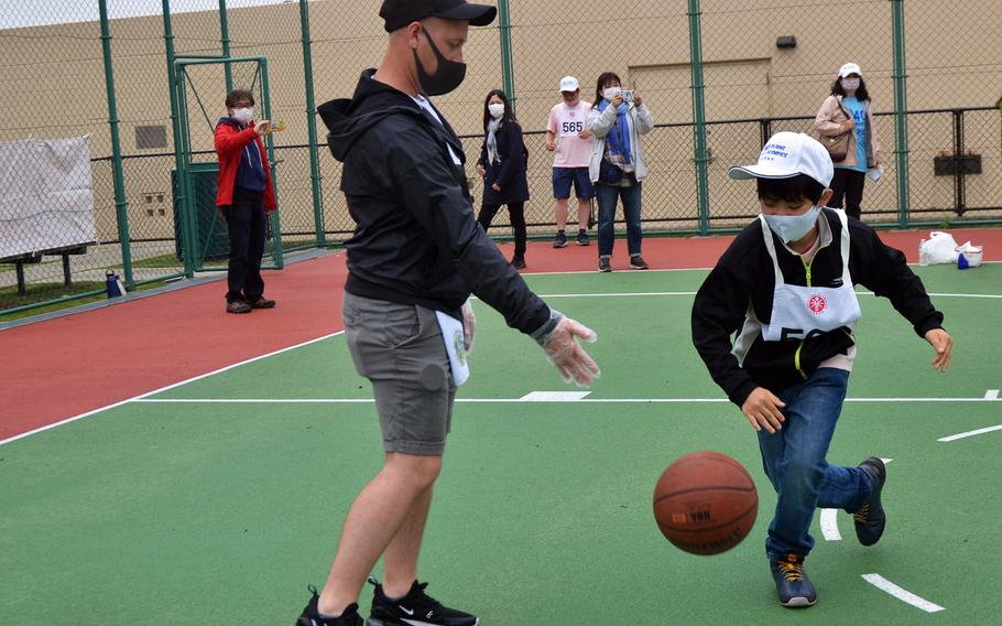 A student from a Tokyo-area school competes in the Kanto Plains Special Olympics at Yokota Air Base, Japan, Saturday, May 22, 2021.