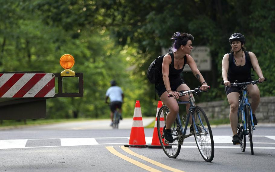 Cyclists in Washington D.C. enjoy a stretch of Beach Drive that is closed to vehicle traffic.