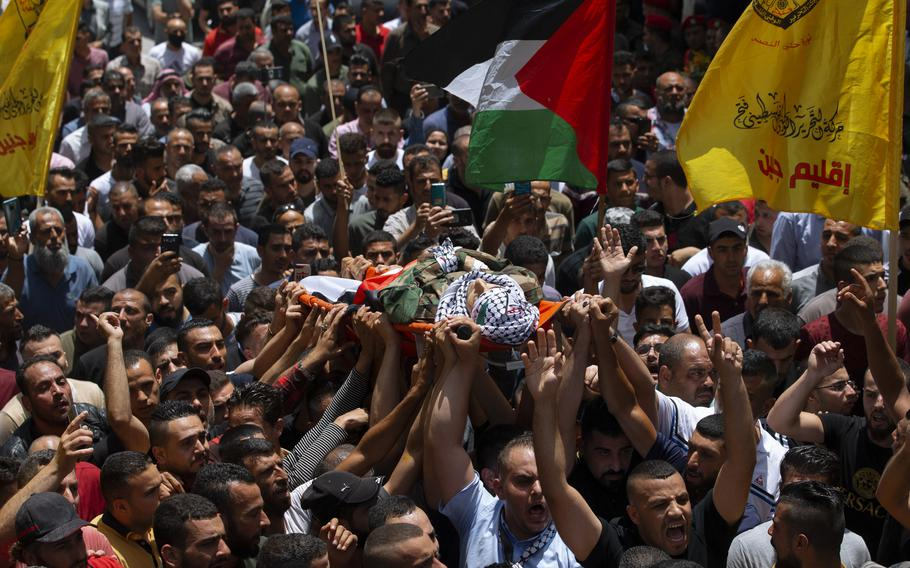 Palestinian mourners carry body of Palestinians security officer, Tayseer Issa, in the West Bank city of Jenin, Thursday, June 10, 2021. Israeli troops shot and killed three Palestinians, including two security officers, in a shootout that erupted in the West Bank town of Jenin during what appeared to be an Israeli arrest raid overnight, Palestinian officials said Thursday. (AP Photo/Majdi Mohammed)