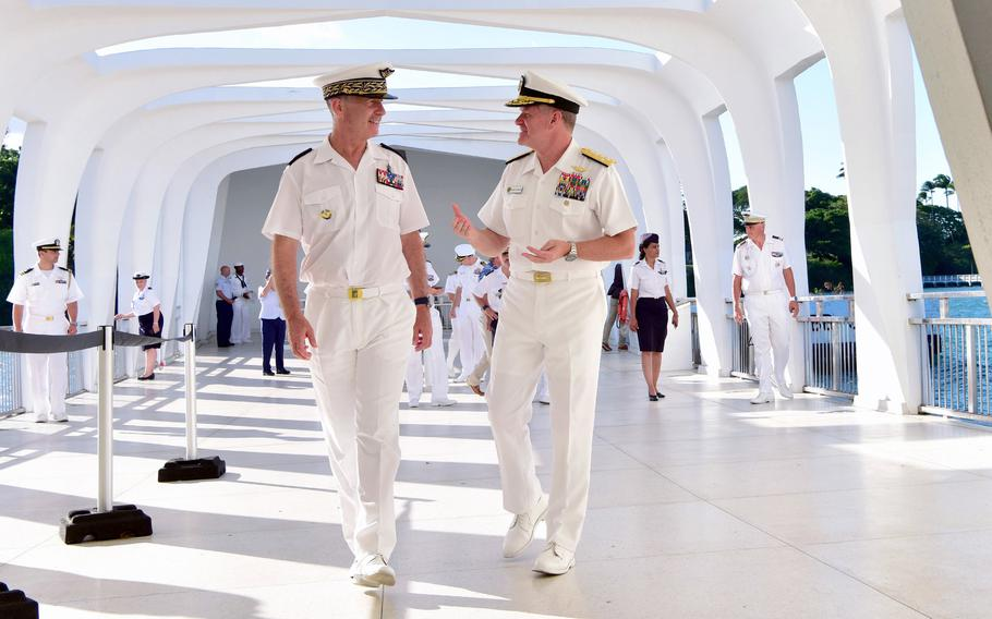 U.S. Pacific Fleet Commander Adm. Samual Paparo, right, speaks with French Air Force Lt. Gen. Vincent Cousin, commander of air defense and air operations, during a recent visit to the USS Arizona Memorial in Hawaii.