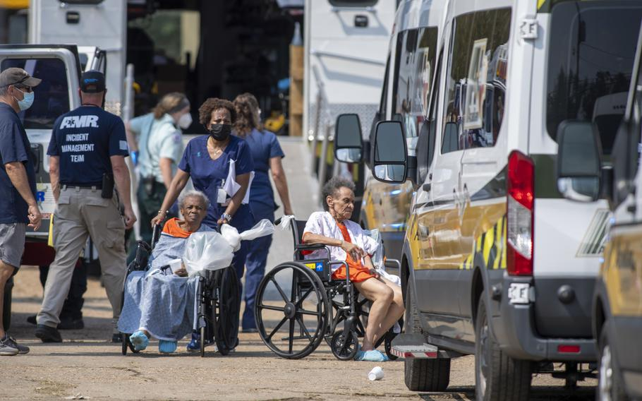 Paramedics evacuate people at a mass shelter Thursday, Sept. 2, 2021, in Independence, La. Multiple nursing home residents died after Hurricane Ida, but full details of their deaths are unknown because state health inspectors said Thursday that they were turned away from examining conditions at the facility to which they had been evacuated.