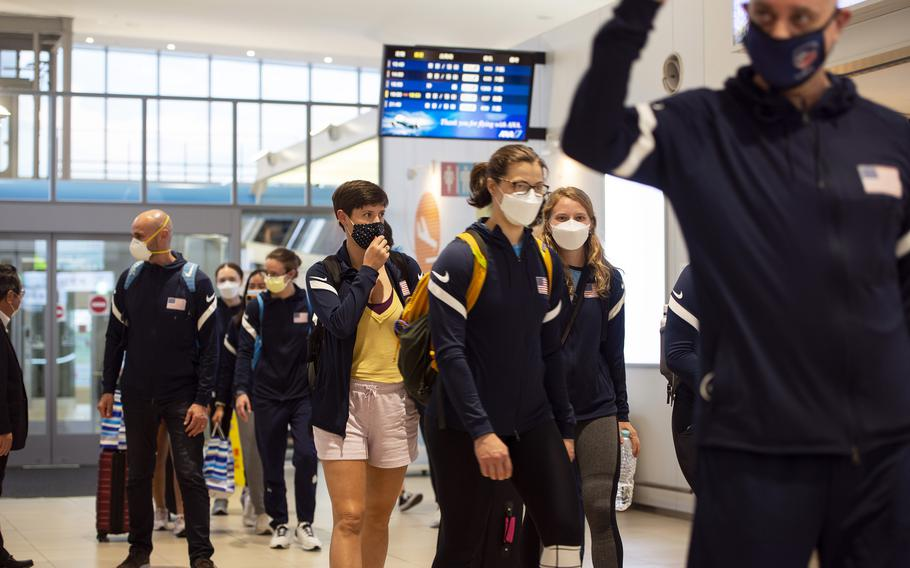 Members of the U.S. women's Olympic fencing team arrive at Marine Corps Air Station Iwakuni, Japan, Tuesday July 13, 2021.