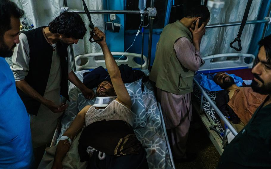 Family members visit wounded patients who have been admitted into Wazir Akbar Khan Hospital in Kabul, Afghanistan, on Thursday, Aug. 26, 2021, following explosions at the airport in Kabul.