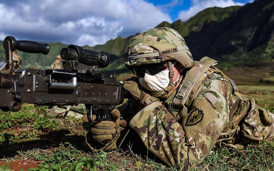A soldier with the 25th Infantry Division looks down the sight of an M240B machine gun during a joint artillery mission at Makua Military Reservation, Hawaii, Aug. 11, 2020.