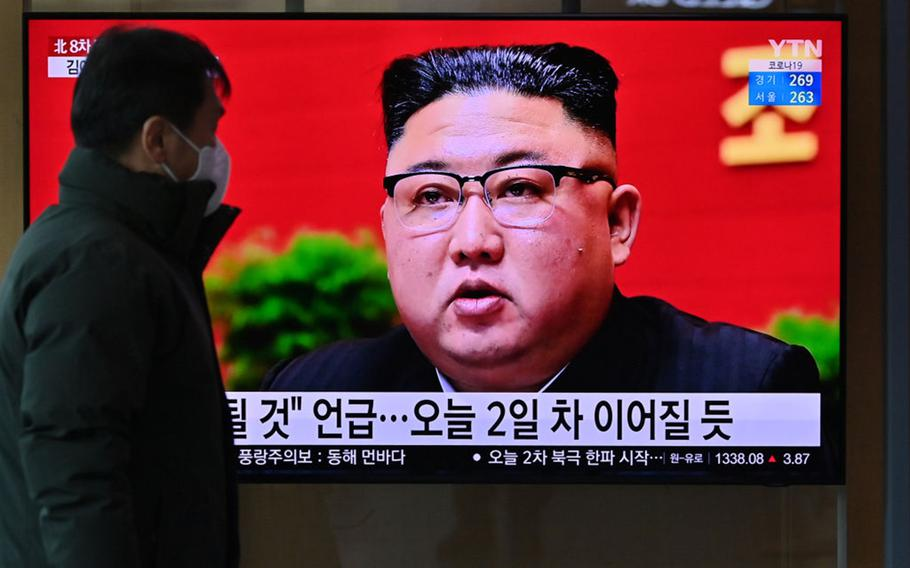 A man watches a television screen showing news footage of North Korean leader Kim Jong Un attending the 8th congress of the ruling Workers' Party held in Pyongyang, at a railway station in Seoul on Jan. 6, 2021.