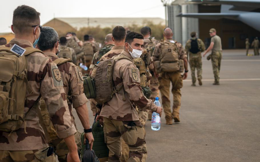 French Barkhane force soldiers who wrapped up a four-month tour of duty in the Sahel board a US Air Force C130 transport plane as they leave their base in Gao, Mali on Wednesday June 9, 2021.
